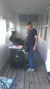 Grandpa grillin the burgers and dogs (no silly, hot dogs!)